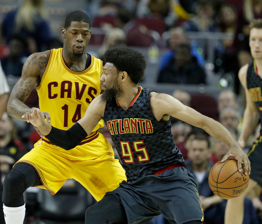 . Atlanta Hawks\' DeAndre Bembry (95) drives past Cleveland Cavaliers\' DeAndre Liggins (14) in the second half of an NBA basketball game, Friday, April 7, 2017, in Cleveland. (AP Photo/Tony Dejak)