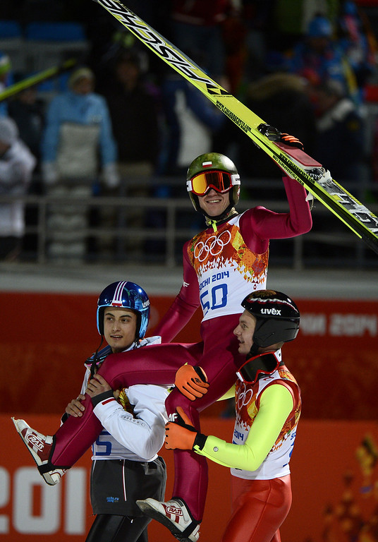 . Poland\'s Kamil Stoch is carried high as he celebrates winning  gold in the Men\'s Ski Jumping Normal Hill Individual Final Round at the RusSki Gorki Jumping Center during the Sochi Winter Olympics on February 9, 2014 in Rosa Khutor.   PIERRE-PHILIPPE MARCOU/AFP/Getty Images