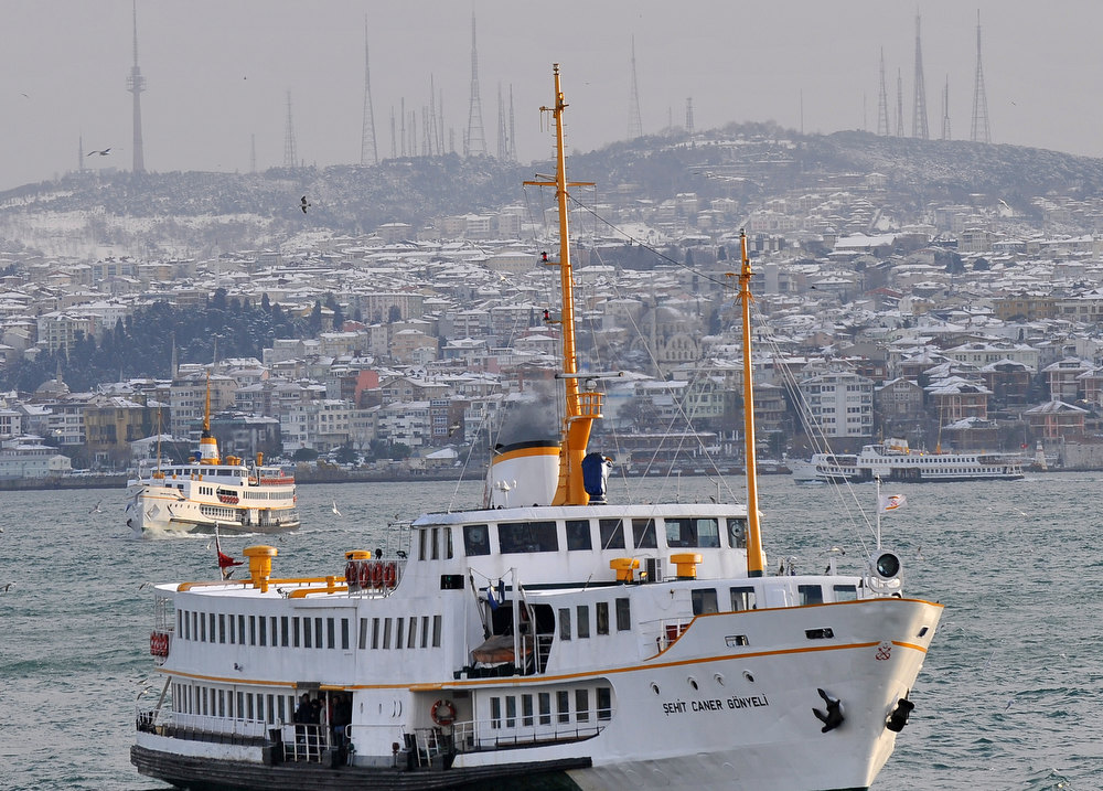 Description of . View shows ferries sailing on the Bosphorus in Istanbul on January 8, 2013. Heavy snowfall blanketed Turkey's commercial hub Istanbul, a city of 15 million, paralysing daily life, disrupting air traffic and land transport. Officials said the snow expected to continue until late tomorrow, according to the weather forecast. BULENT KILIC/AFP/Getty Images