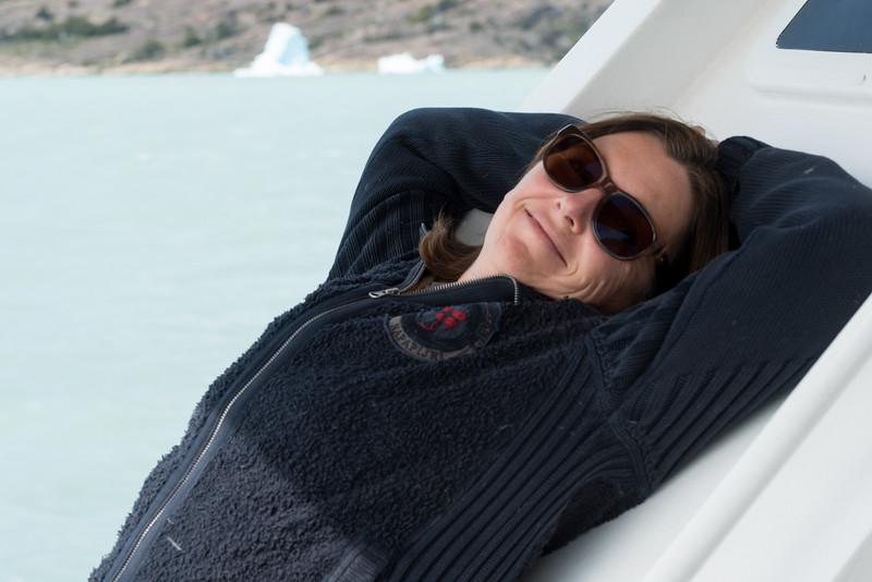 Woman relaxing at Lake Argentino, Santa Cruz Province, Patagonia, Argentina