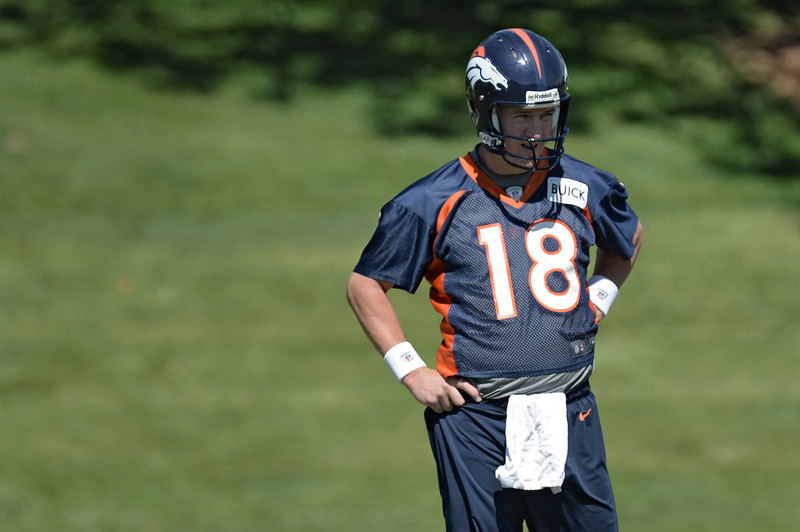 . Peyton Manning (18) QB of the Denver Broncos looks on during OTAs June 3, 2013 at Dove Valley. (Photo By John Leyba/The Denver Post)
