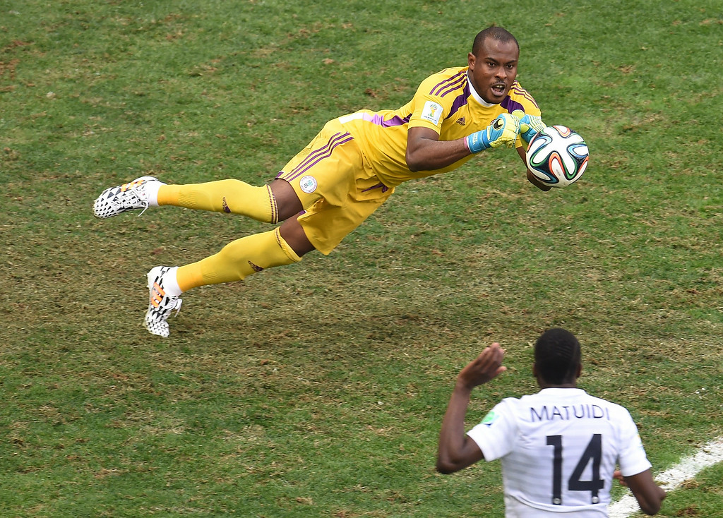 . Nigeria\'s goalkeeper Vincent Enyeama (top) defends his goal during a Round of 16 football match between France and Nigeria at Mane Garrincha National Stadium in Brasilia during the 2014 FIFA World Cup on June 30, 2014.  VARISTO SA/AFP/Getty Images