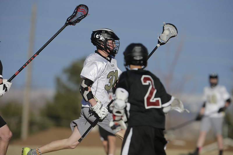JPM0013-JPM0013-Jonathan first HS lacrosse game March 9th.jpg