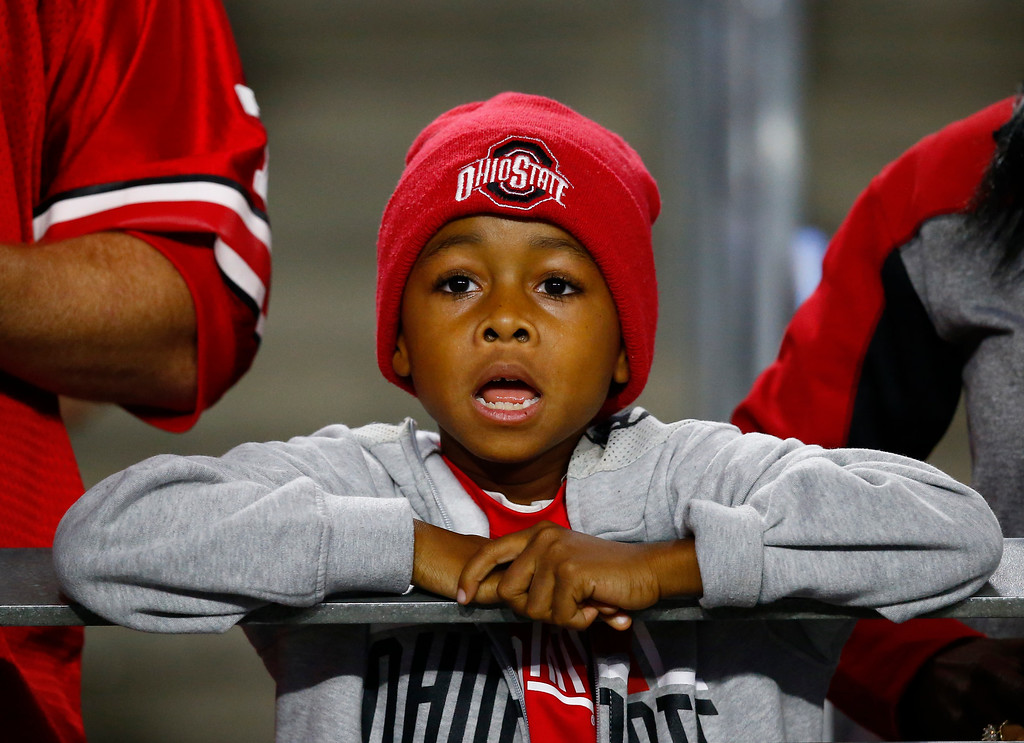 . An Ohio State fan watches during the first half of the Fiesta Bowl NCAA college football game against Clemson, Saturday, Dec. 31, 2016, in Glendale, Ariz. (AP Photo/Ross D. Franklin)