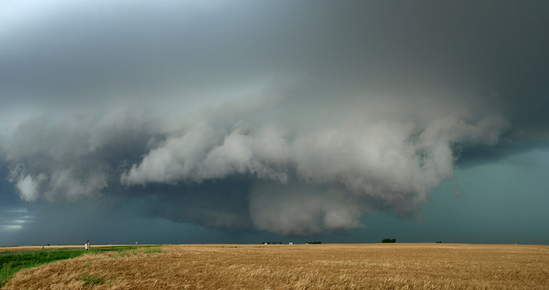 What a stunning capture and strong image this is. The power, structure and colours could not have been better. It was indeed as wild as it looked. It's not nice when you get caught inside of one these beasts. The ferocious winds and hail can tear a car (or house) to pieces. Two images here make up the panorama, which looks stunning across a double page spread. Olympus E3, 12-60mm SWD - F5.6, 1/13s