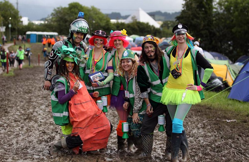 GLASTONBURY, ENGLAND - JUNE 22:  The festival 'Green Police' patrol walks at the Glastonbury Festival site at Worthy Farm, Pilton on June 22, 2011 in Glastonbury, England. Heavy rain and mud greeted music fans as the gates to the five-day festival opened to the public this morning. This year the festival will feature headline acts U2, Coldplay and Beyonce. The festival, which started in 1970 when several hundred hippies paid one GBP to watch Marc Bolan, has grown into Europe's largest music festival attracting more than 175,000 people over five days.  (Photo by Matt Cardy/Getty Images)