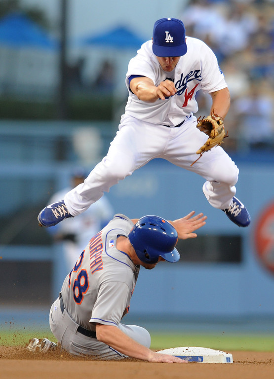 . Dodgers Mark Ellis leaps over Mets Daniel Murphy to complete a double play in the first inning.  The Dodgers play the New York Mets in a game at Dodger Stadium in Los Angeles, CA. 8/13/2013(John McCoy/LA Daily News)