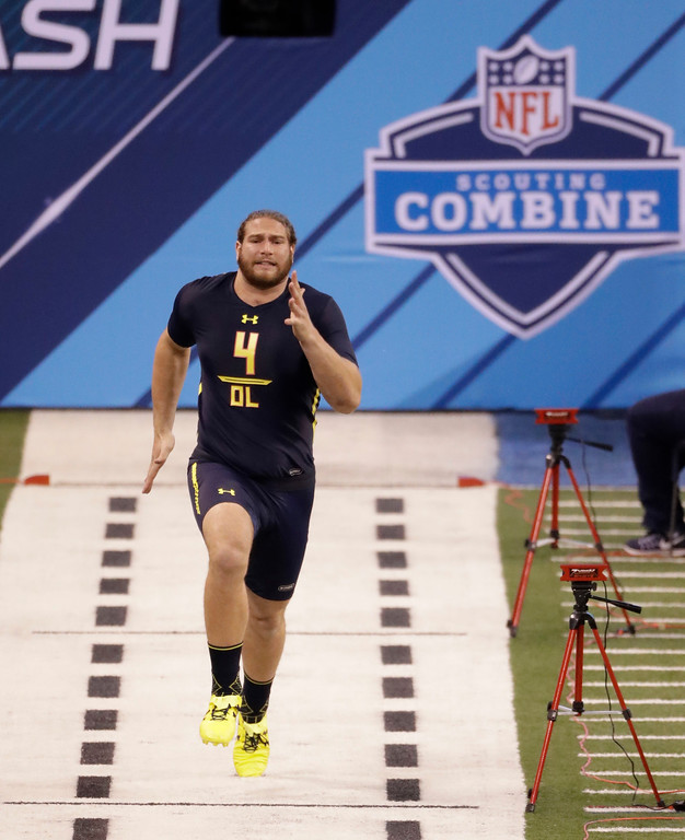 . Pittsburgh offensive lineman Adam Bisnowaty runs the 40-yard dash at the NFL football scouting combine Friday, March 3, 2017, in Indianapolis. (AP Photo/David J. Phillip)