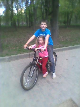 2011-05-09, Ilia and Olya on a bike