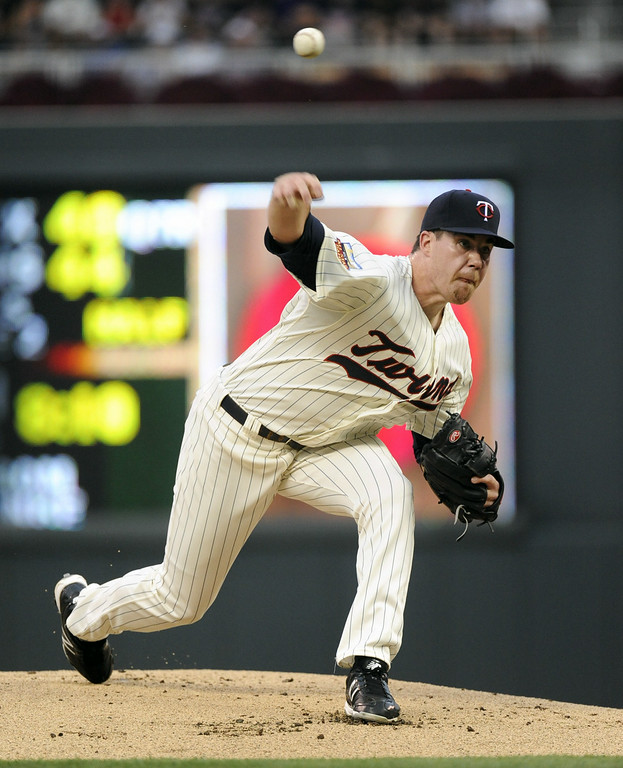 . Minnesota Twins pitcher Trevor May throws against the Detroit Tigers during the first inning of a baseball game Saturday, Aug. 23, 2014 in Minneapolis.  (AP Photo/Craig Lassig)