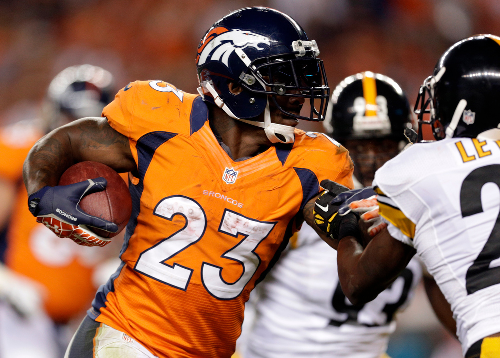 . In this Sept. 9, 2012, Denver Broncos running back Willis McGahee runs against the Pittsburgh Steelers during the fourth quarter of an NFL football game in Denver. The Broncos have released McGahee, Thursday, June 13, 2013, their leading rusher last year.  (AP Photo/Joe Mahoney, File)
