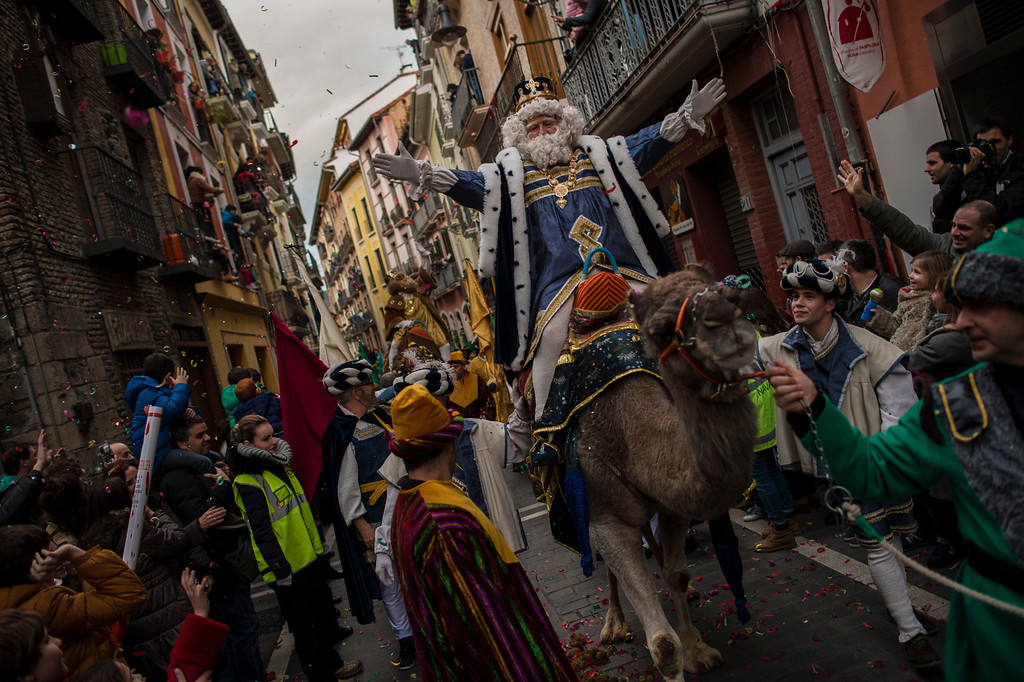 . . The Cabalgata Los Reyes Magos (Cavalcade of the three kings) cross one street of the old city the day before Epiphany, in Pamplona, northern Spain, Tuesday, Jan. 5, 2016. It is a parade symbolizing the coming of the Magi to Bethlehem following the birth of Jesus. In Spain and many Latin American countries Epiphany is the day when gifts are exchanged. (AP Photo/Alvaro Barrientos)