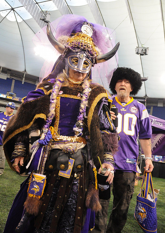 """. It took Queen Helga, a.k.a. Carol Jensen, an hour to dress for the Vikings Draft Party, along with her king, Eric \""""Thorn\"""" Jensen. (Pioneer Press: John Autey)"""