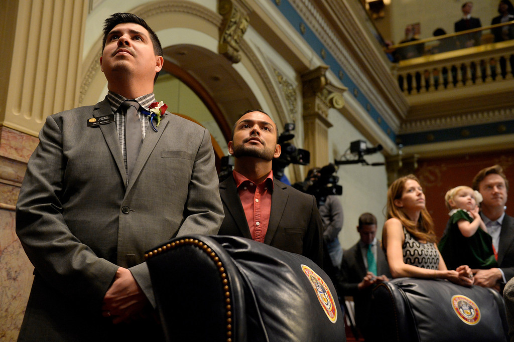 . DENVER, CO. - JANUARY 08:Senator Jessie Ulibarri, left, and his partner, Louis Trujillo, stand during the opening of the first day of the new legislative session at the Colorado Capitol in Denver, CO January 08, 2014. (Photo By Craig F. Walker / The Denver Post)