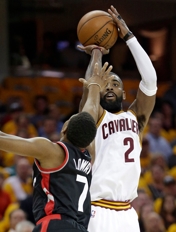 . Cleveland Cavaliers\' Kyrie Irving (2) shoots over Toronto Raptors\' Kyle Lowry (7) in the first half in Game 1 of a second-round NBA basketball playoff series, Monday, May 1, 2017, in Cleveland. (AP Photo/Tony Dejak)