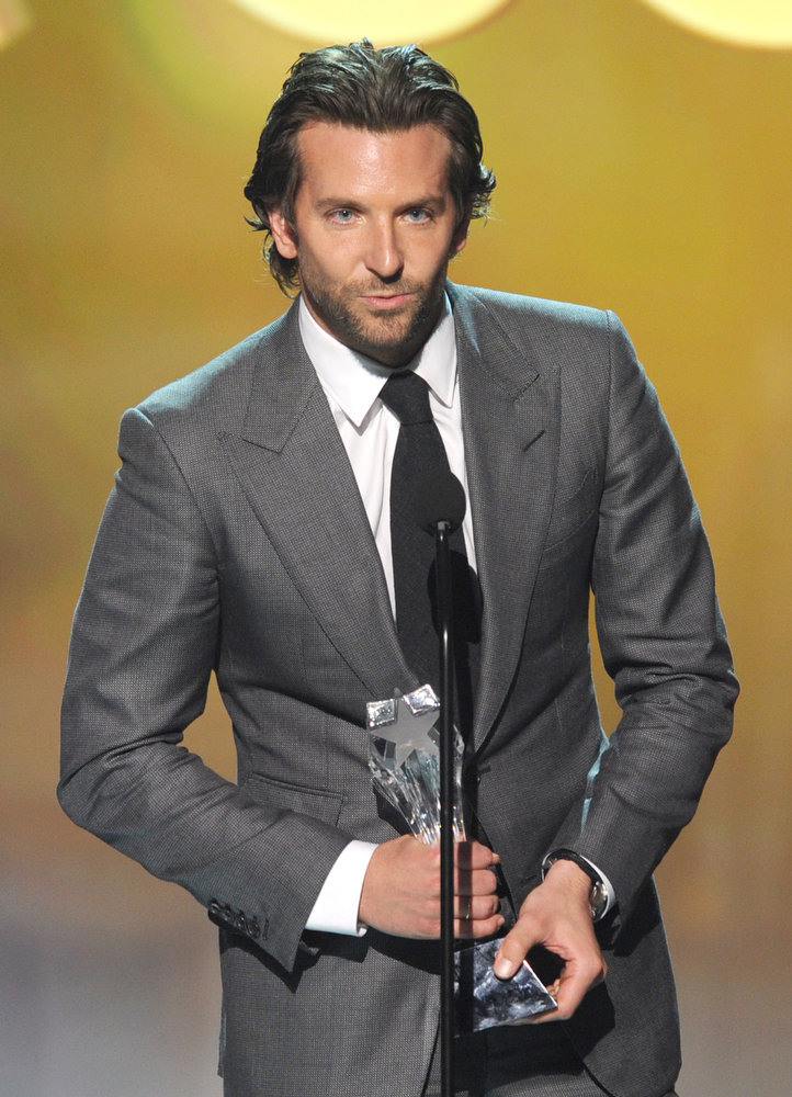 ". Actor Bradley Cooper accepts the Best Actor in a Comedy Award for ""Silver Linings Playbook\"" onstage at the 18th Annual Critics\' Choice Movie Awards held at Barker Hangar on January 10, 2013 in Santa Monica, California.  (Photo by Kevin Winter/Getty Images)"