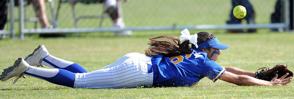 . Bishop Amat left fielder Alyssa Barerra dives for a double by Santiago\'s Kaylin Crumpton (not pictured) in the third inning of a prep softball game at Bishop Amat High School on Wednesday, March 27, 2013 in La Puente, Calif. Bishop Amat won 5-3.  (Keith Birmingham Pasadena Star-News)