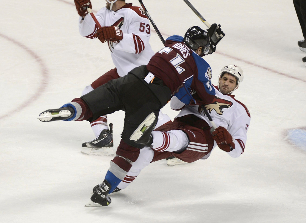 . DENVER, CO. - FEBRUARY 11: David JOnes (54) of the Colorado Avalanche puts a big hit on Boyd Gordon (15) of the Phoenix Coyotes duirng the seond period February 11, 2013 at Pepsi Center.(Photo By John Leyba/The Denver Post)