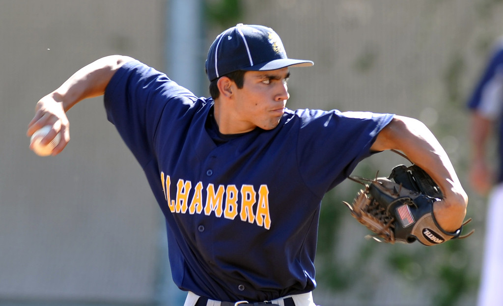 . Alhambra\'s Jose Amezquita (#8) makes a pitch as they play Montebello in their Almont League baseball game at Montebello High School in Montebello  on Friday April 19, 2013. (SGVN/Staff Photo by Keith Durflinger)