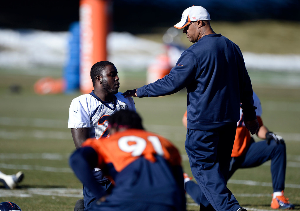 . Denver Broncos running backs coach Eric Studesville chats with Denver Broncos running back Montee Ball (28) prior to practice November 27, 2013 at Dove Valley (Photo by John Leyba/The Denver Post)