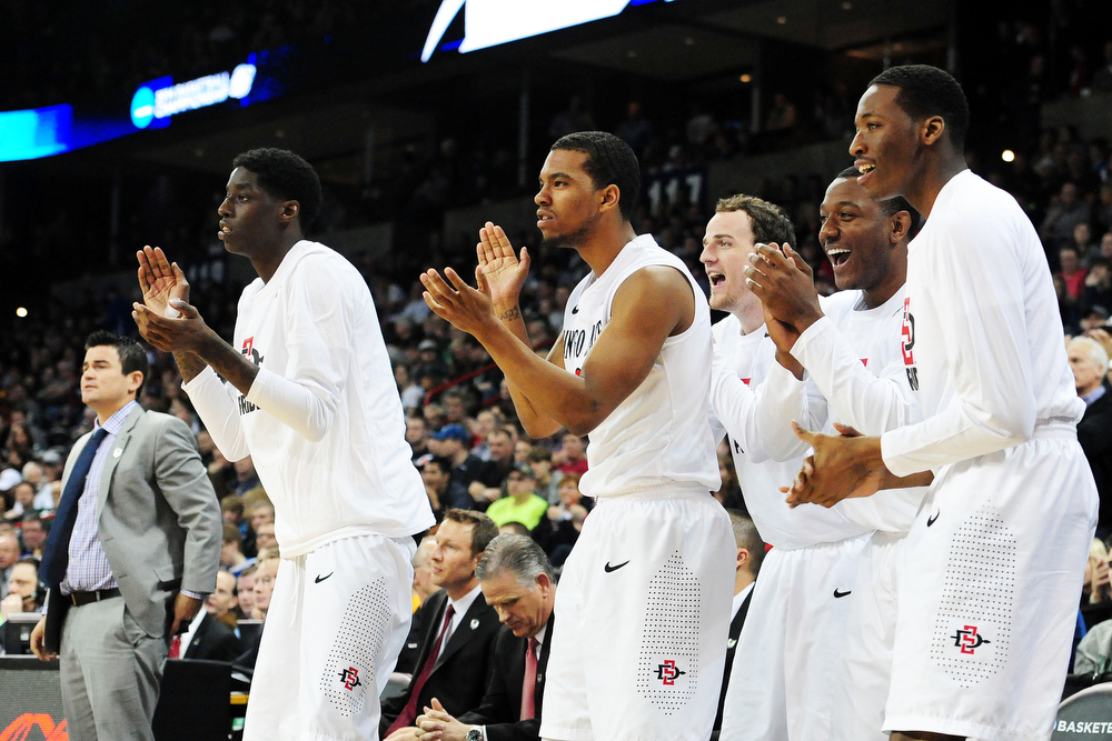 . The San Diego State Aztecs bench celebrates in the second half against the North Dakota State Bison during the Third Round of the 2014 NCAA Basketball Tournament at Spokane Veterans Memorial Arena on March 22, 2014 in Spokane, Washington.  (Photo by Steve Dykes/Getty Images)