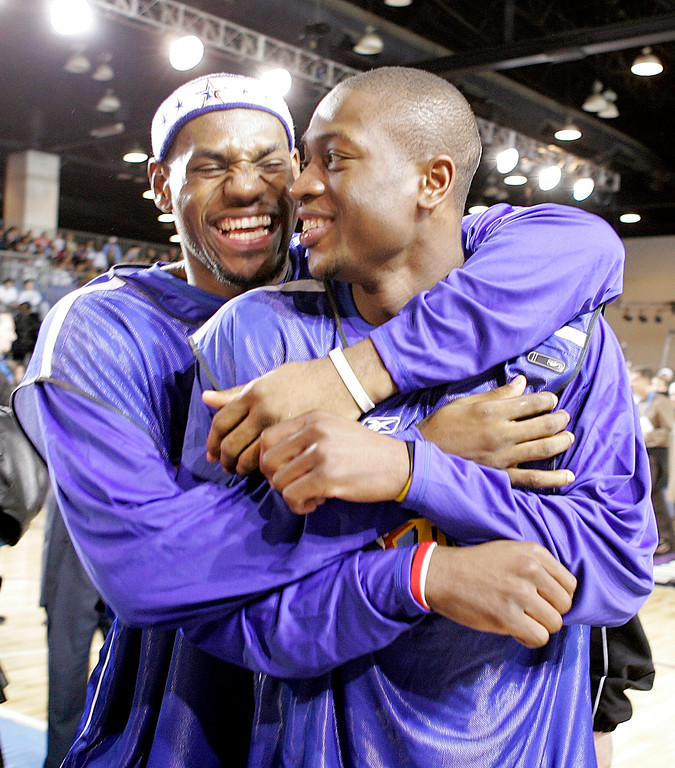 . Cleveland Cavaliers\' LeBron James, left, hugs Miami Heat guard Dwyane Wade prior to the NBA All Star practice session Saturday, Feb. 19, 2005 at the Convention Center in Denver. (AP Photo/Mark J. Terrill)