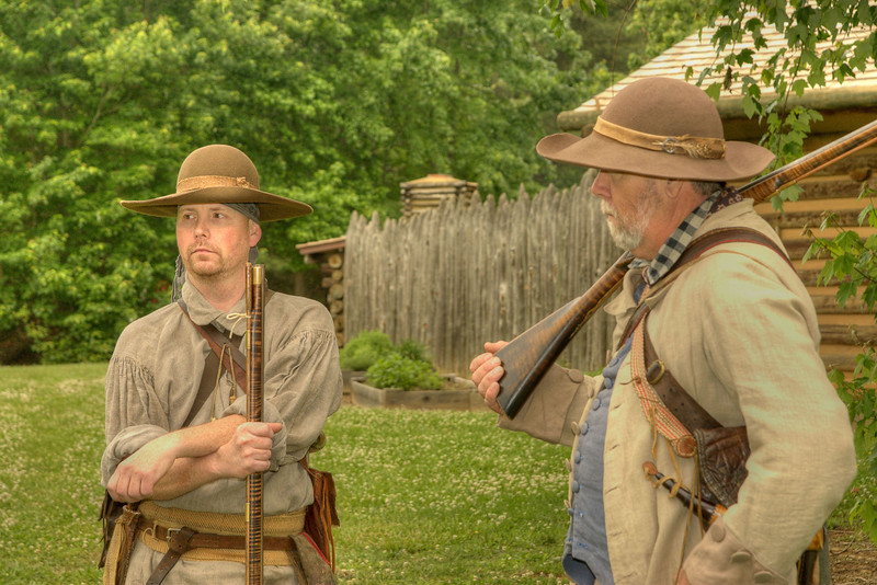 Reenactors stand outside the recreation of Fort Watauga during the Siege of Fort Watauga at Sycamore Shoals State Park in Elizabethton, VA on Saturday, May 17, 2014. Copyright 2014 Jason Barnette  The Siege of Fort Watauga is a two-day reenactment held each year at the recreation of the fort inside Sycamore Shoals State Historic Park. The reenactment brings in dozens of reenactors and hundreds of visitors as they tell the story of an attack on the early settlers village by Dragging Canoe, and how they successfully defended themselves. During the reenactment, the fort is open to the public with demonstrations of all areas of early settler life on the frontiers.
