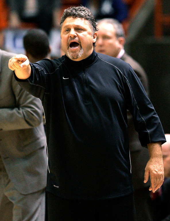 . Oakland head coach Greg Kampe talks to his players during the first half of an NCAA college basketball game against Boise State, Tuesday, Nov. 13, 2012, in Boise, Idaho. (AP Photo/Matt Cilley)