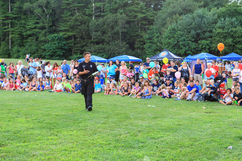 Kingston Police K-9 officer Michael Lanatra, explains to the crowd the next K-9 tactic they are about to see at the National Night Out event.