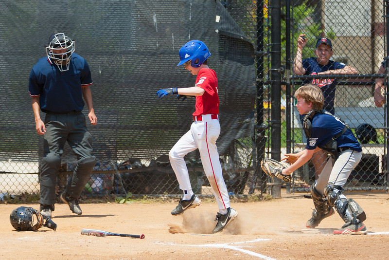 Sam is tagged out at home plate to end the top of the 4th inning with the Nats leading 6-4. The bats of the Nationals were supported by a great defensive outing in a 11-4 win over the Twins. They are now 7-3 for the season. 2012 Arlington Little League Baseball, Majors Division. Nationals vs Twins (13 May 2012) (Image taken by Patrick R. Kane on 13 May 2012 with Canon EOS-1D Mark III at ISO 400, f4.0, 1/2500 sec and 170mm)