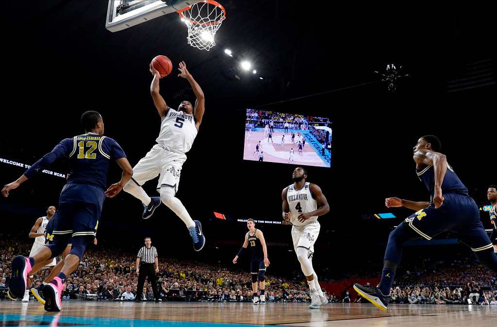 . Villanova\'s Phil Booth (5) goes up for a shot against Michigan\'s Muhammad-Ali Abdur-Rahkman (12) during the first half in the championship game of the Final Four NCAA college basketball tournament, Monday, April 2, 2018, in San Antonio. (AP Photo/Eric Gay)