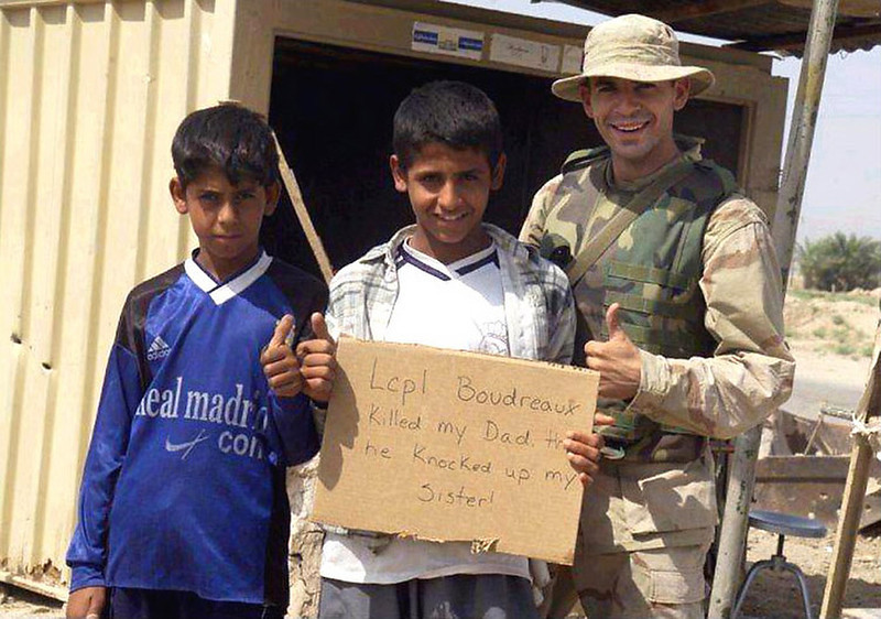 """. April 2004:  This image, which was widely circulated on the Internet, shows a U.S. Marine posing for a photo with two Iraqi children while holding a sign reading \""""Lcpl Boudreauk killed my Dad then he knocked up my sister\"""". Boudreauk claims that this image was tampered with from the original, in which the sign read \""""Welcome Marines\"""". A military investigation into potential wrong-doing was inconclusive. It remains unclear if this image is authentic.   SOURCE: http://www.cs.dartmouth.edu/farid/research/digitaltampering/"""