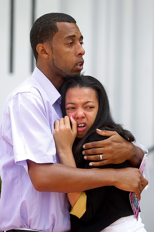 . Guests cry as they exit McNary-Williams-Jackson Mortuary after funeral services for Alaysha Carradine ,8, on Tuesday, July 30, 2013 in Oakland, Calif.  Carradine was shot and killed during a sleepover at a friends house in the 3400 block of Wilson Avenue earlier this month in Oakland.   (Aric Crabb/Bay Area News Group)
