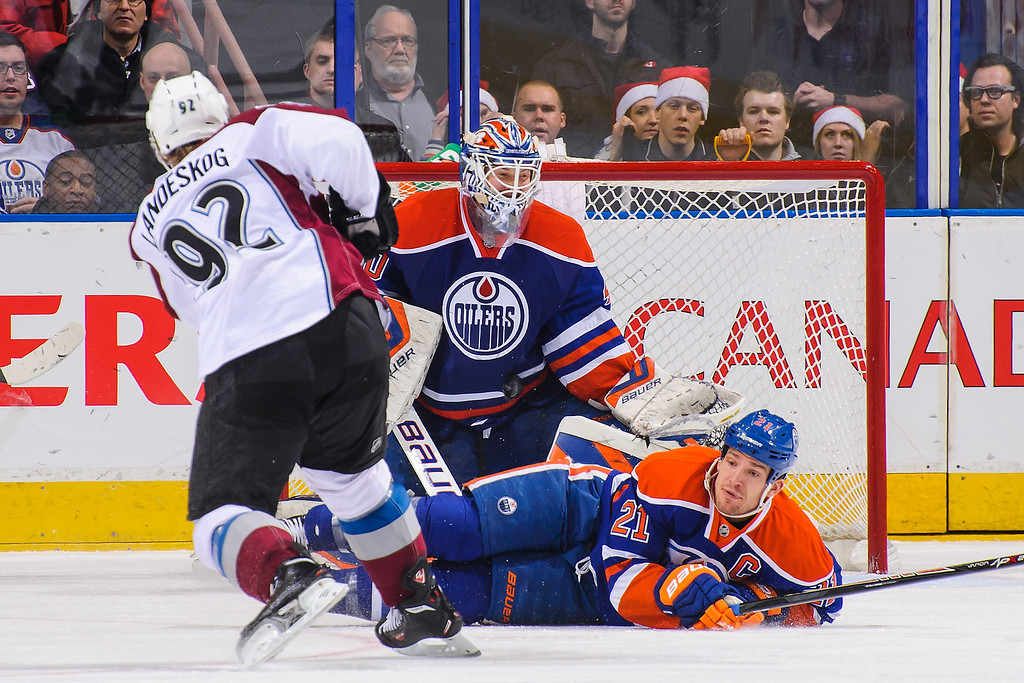 . EDMONTON, AB - DECEMBER 5: Andrew Ference #21 and Devan Dubnyk #40 of the Edmonton Oilers defend against Gabriel Landeskog #92 of the Colorado Avalanche during an NHL game at Rexall Place on December 5, 2013 in Edmonton, Alberta, Canada. (Photo by Derek Leung/Getty Images)