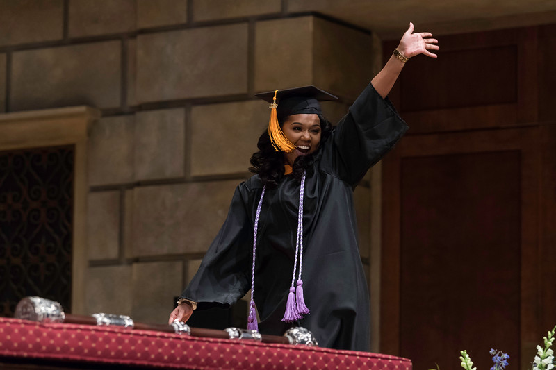 ReNika A. Dixon celebrates as she crosses the stage after receiving his bachelor of science degree. // University of Rochester School of Nursing Commencement, Kodak Hall at Eastman Theatre May 17, 2019.  // photo by J. Adam Fenster / University of Rochester