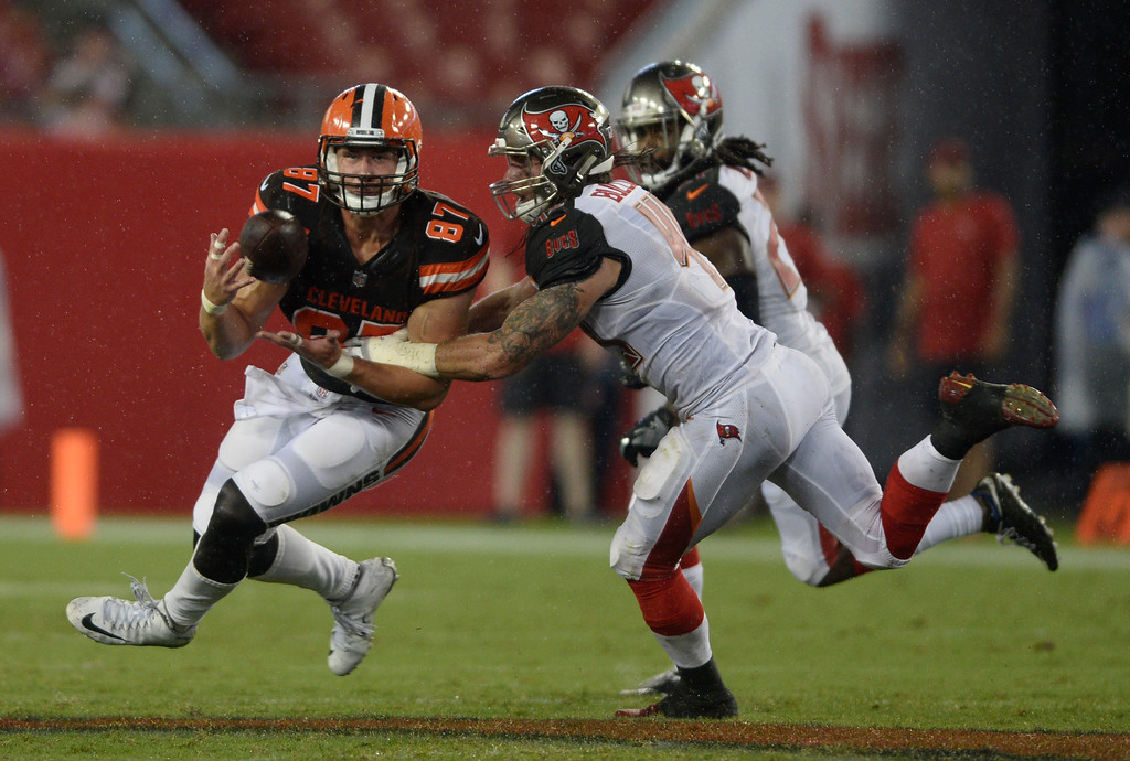 . Cleveland Browns tight end Seth DeValve (87) makes a catch in front of Tampa Bay Buccaneers linebacker Riley Bullough (49) during the fourth quarter of an NFL preseason football game Saturday, Aug. 26, 2017, in Tampa, Fla. (AP Photo/Jason Behnken)