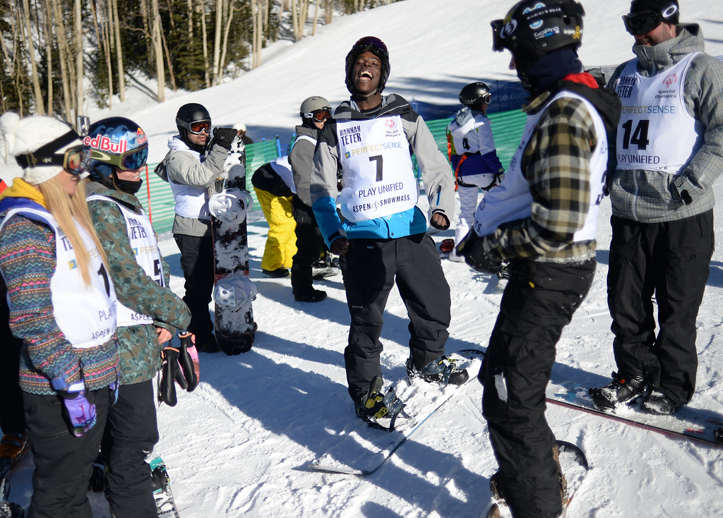 . Special Olympic athlete Coney Foutenelle, center, celebrates after racing with Winter X Games athletes at Aspen Mountain, January, 26 2014. The athlete spent the afternoon racing and having fun.  (Photo by RJ Sangosti/The Denver Post)