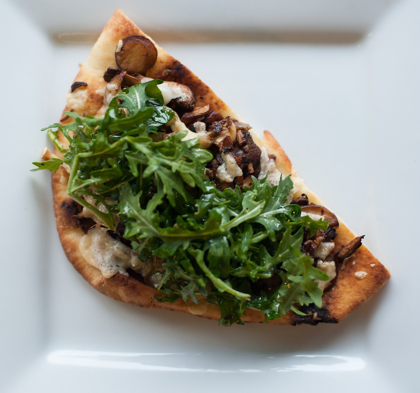 . Mushroom & parmesan flatbread is shown at the Market on Main in downtown Mt. Pleasant. Chef Emma Currie of the Brass Cafe shares her tips for using and preparing mushrooms. (Sun photos by Holly Mahaffey/@hollymahaffey)