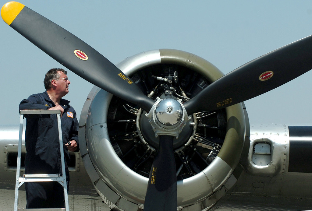 . (Thomas R. Cordova/Staff Photographer) Ken Morris, left co-pilot, looks at one of the engines on a WWII B-17 Bomber in Chino April 29, 2013. he Boeing B-17 Flying Fortress is a World War II bomber used primarily in Europe. B-17s from the Eighth Air Force participated in countless missions from bases in England. These missions often lasted for more than eight hours and struck at targets deep within enemy territory. Because of their long-range capability, formations of B-17s often �ew into battle with no �ghter escort, relying on their own defensive capabilities to ensure a successful mission.(Thomas R. Cordova/Staff Photographer)
