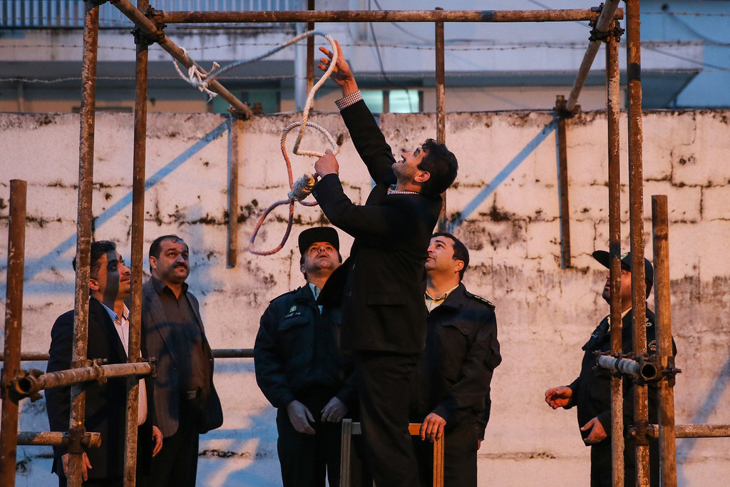 . Officials prepare the noose for the execution of Balal, who killed an Iranian youth Abdolah Hosseinzadeh in a street fight with a knife in 2007, during his execution ceremony in the northern city of Nowshahr on April 15, 2014.  AFP PHOTO/ARASH KHAMOOSHI/AFP/Getty Images