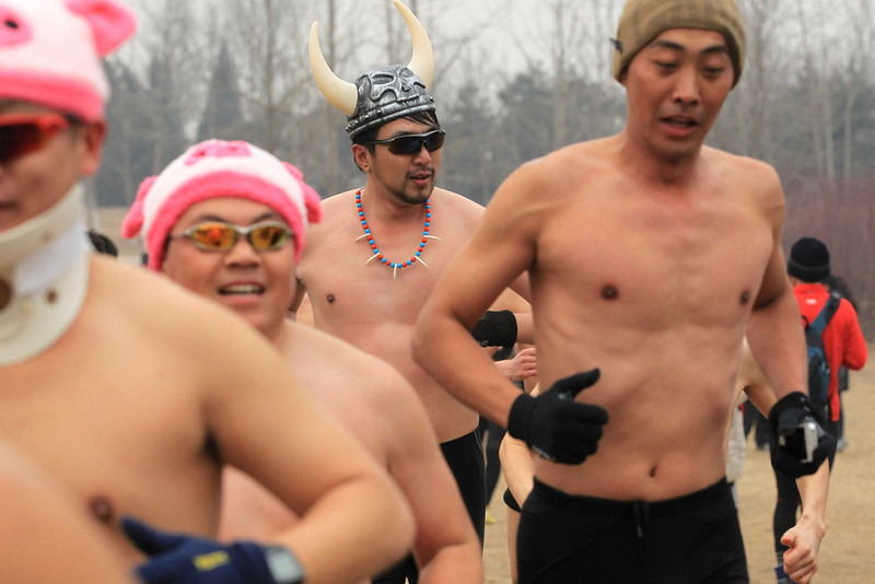 . This picture taken on February 24, 2013 shows paticipants taking part in the annual 3.5 km Undie Run held in the Olympic Forest Park in Beijing. Some 300 participants wanted to prove that Chinese can brave the cold just as well as any nationality and promote nationwide fitness. There were no winners, no trophies and no starting gun or finishing line.  AFP PHOTOAFP/AFP/Getty Images