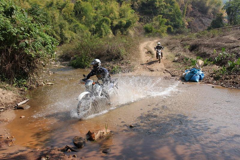 Sa-ngiam crosses a stream