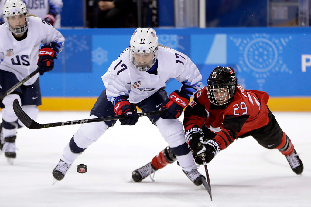 . Jocelyne Lamoureux-Davidson (17), of the United States, and Marie-Philip Poulin (29), of Canada, compete for the puck during the second period of a preliminary round during a women\'s hockey game at the 2018 Winter Olympics in Gangneung, South Korea, Thursday, Feb. 15, 2018. Canada won 2-1. (AP Photo/Julio Cortez)