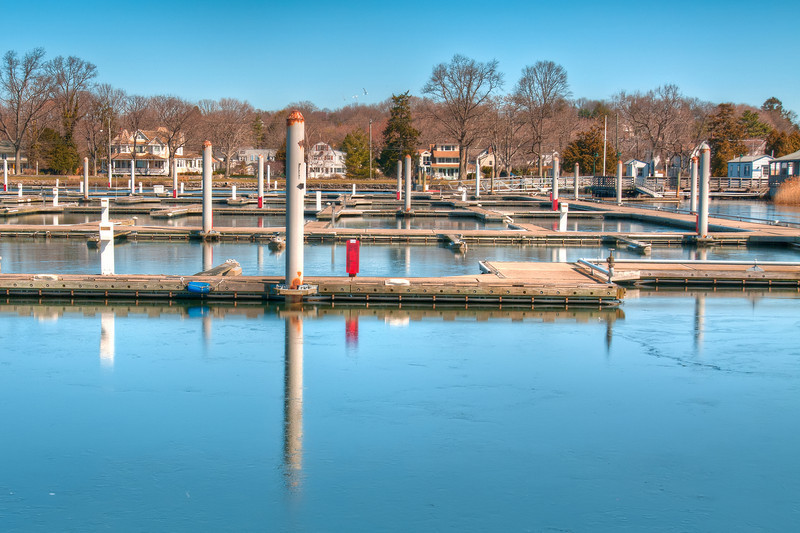 The empty docks at Compo Beach in Westport. In the summer time these docks are full of boats but in the winter everyone vacates. I liked the repetive emptyness/rows of the docks here.