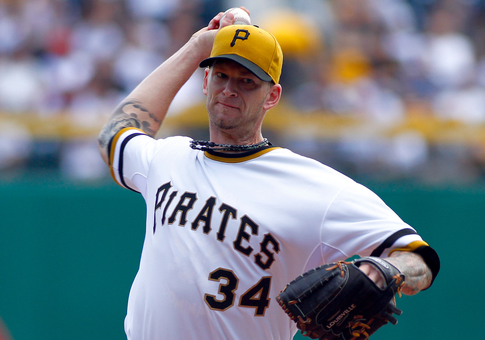 . A.J. Burnett #34 of the Pittsburgh Pirates pitches in the first inning against the Colorado Rockies during the game on August 4, 2013 at PNC Park in Pittsburgh, Pennsylvania.  (Photo by Justin K. Aller/Getty Images)