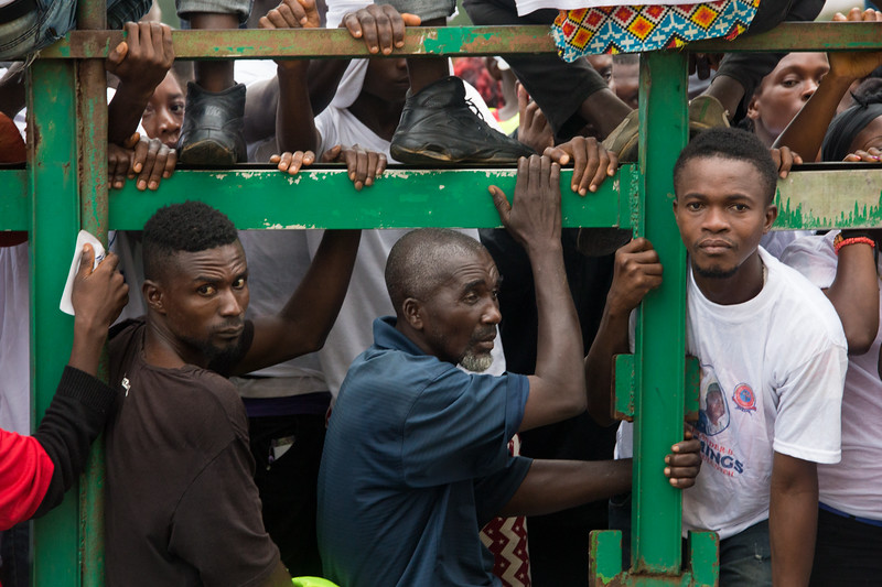 Monrovia, Liberia October 7, 2017 - People ride on a truck  to show support for their candidate prior to the 2017 presidential election.