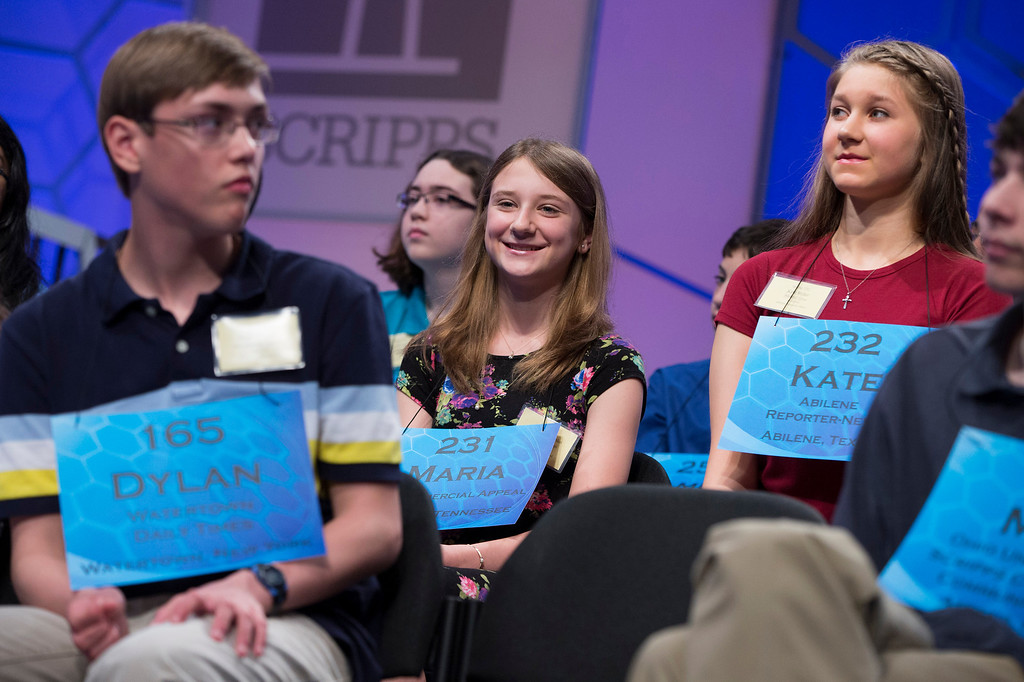 ". Maria Kaltchenko of Tupelo, Miss., smiles after spelling the word ""pointelle\"" correctly during the semifinal round of the National Spelling Bee, on Thursday, May 29, 2014, in Oxon Hill, Md. (AP Photo/ Evan Vucci)"