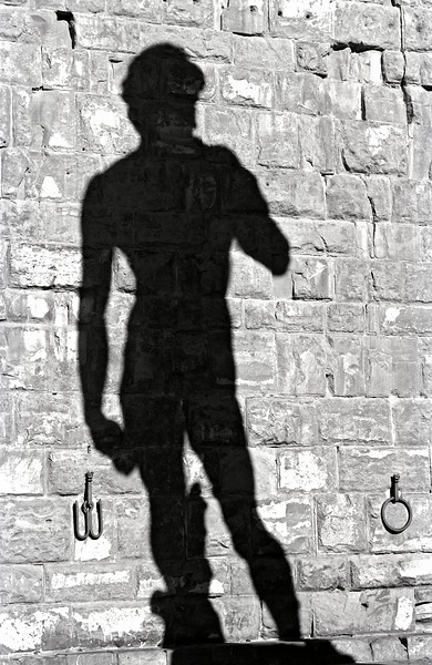 Shadow Cast by Michelangelo's Statue of David in Piazza della Signoria in Florence, Italy