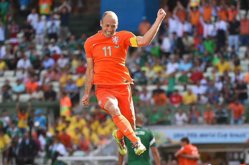 . Netherlands\' forward Arjen Robben celebrates after victory in the Round of 16 football match between Netherlands and Mexico at Castelao Stadium in Fortaleza during the 2014 FIFA World Cup on June 29, 2014.   EMMANUEL DUNAND/AFP/Getty Images