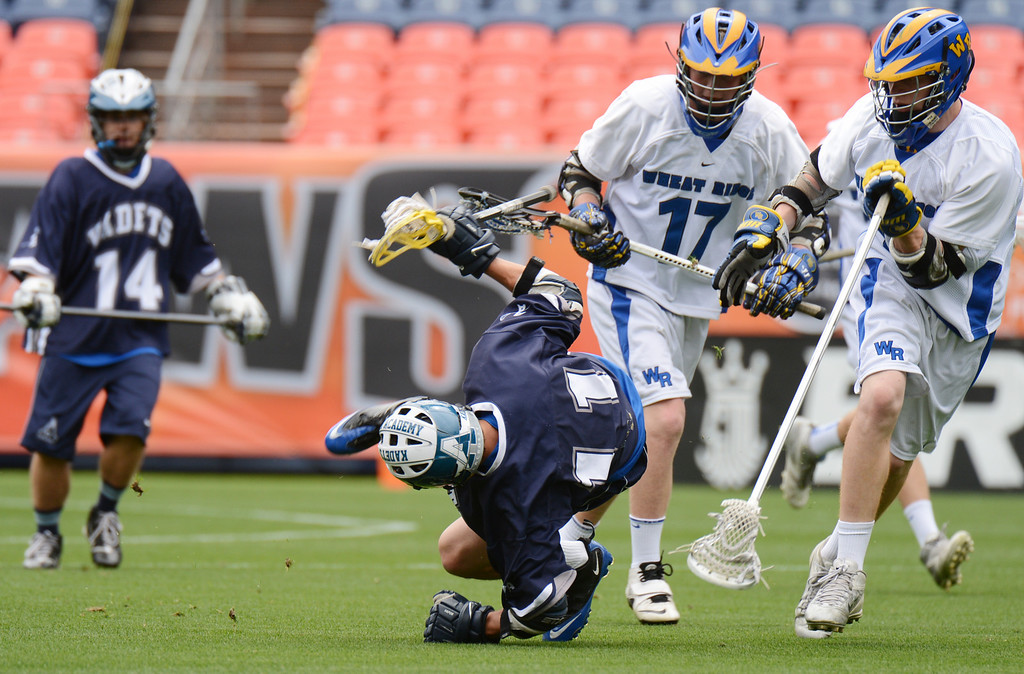 . DENVER, CO. - MAY 18 : Ben Brown of Air Academy High School (11) is checked by Wheat Ridge High School defenders during 4A Boy\'s Lacrosse Championship game at Sports Authority Field at Mile High Stadium. Denver, Colorado. May 18, 2013. (Photo By Hyoung Chang/The Denver Post)